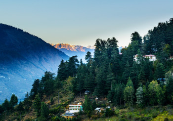 Sunrise in Kulu valley with Himalayas range in background